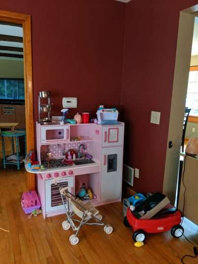 Cluttered Play Area Before Neatly Placed LLC